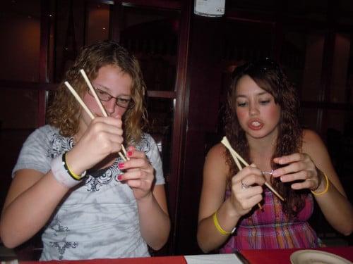 white women eating chinese food